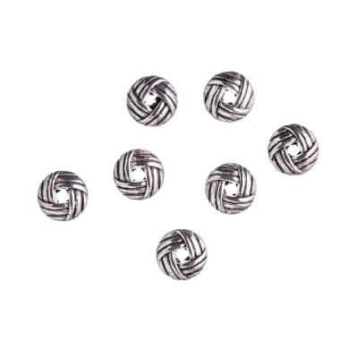 Distanziatore in Stile Tibetano intrecciato color Argento da 0.6 cm - 20 pz.