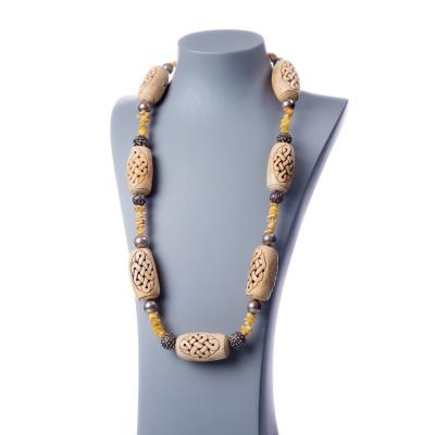 Collana con elementi in Osso, Ambra e Argento Tibetano