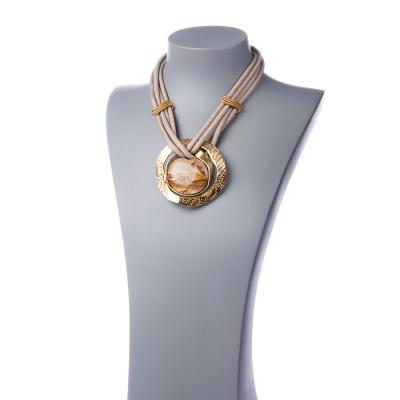 Collana con pendente di Pietra Paesina e fili in tessuto