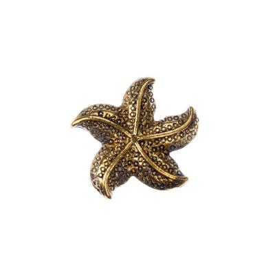 Distanziatore Tibetano Stella Marina color Oro 1.9x2.1 cm - 1 pz.