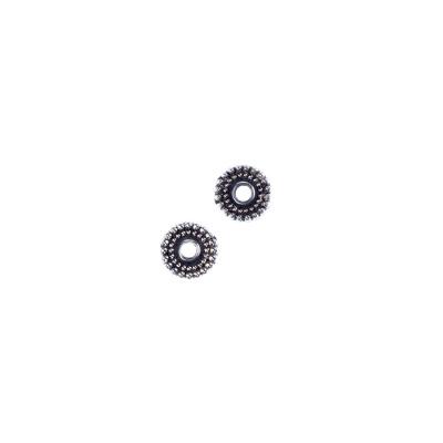 Distanziatore Dentato Tibetano color Argento diametro 0.6 cm - 8.1 gr. (circa 40 pz)