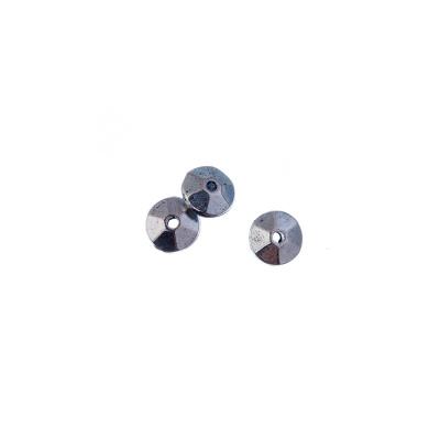 Distanziatore Tibetano a disco sfaccettato color Argento diametro 0.6 cm - 6.1 gr. (circa 20 pz)