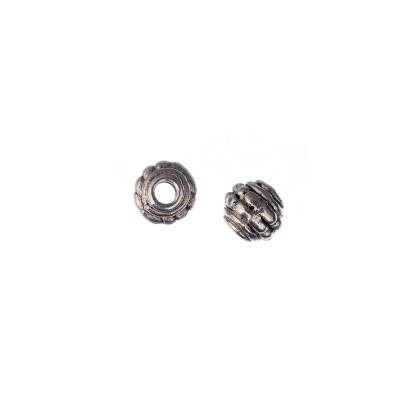 Distanziatore Tibetano rotondo decorato color Argento diametro 0.7 cm - 20 pz